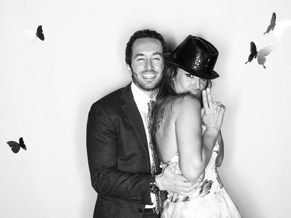 Photo of cool couple using The Little White Photobooth