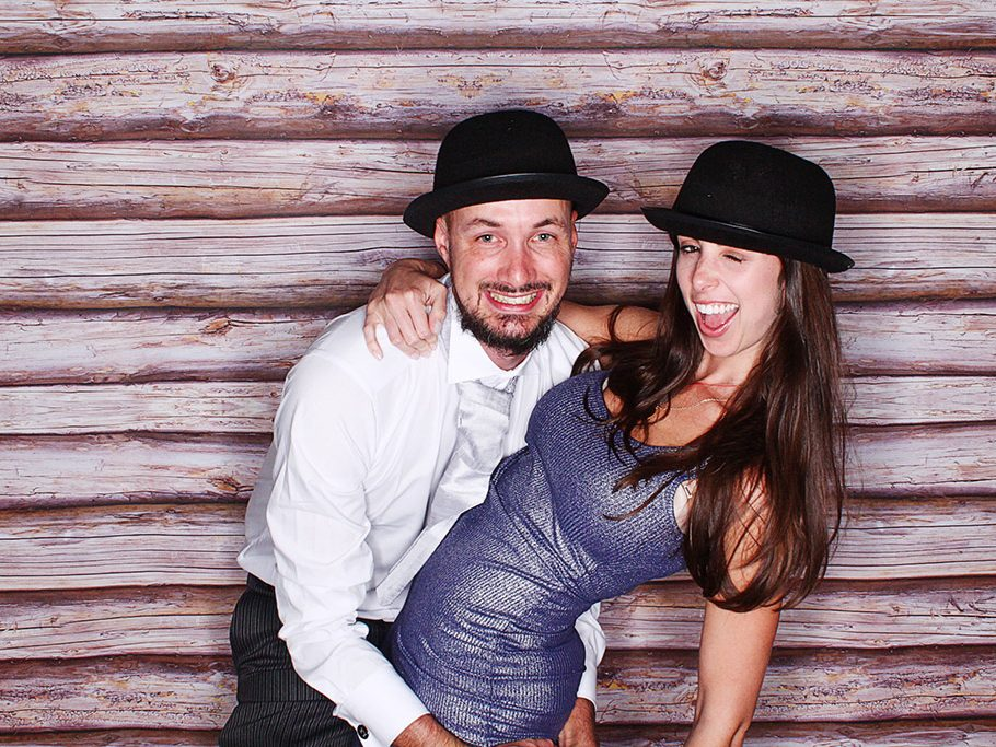 Man in white shirt and lady in blue dress using Portsmouth photobooth