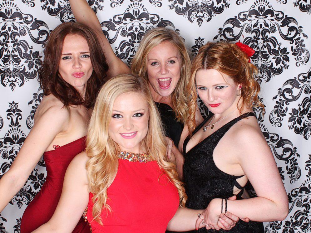 Girls having fun in wedding photobooth in Surrey