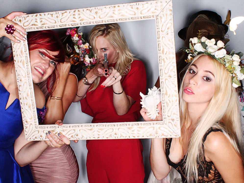 guests having fun using Photo booth rental for weddings