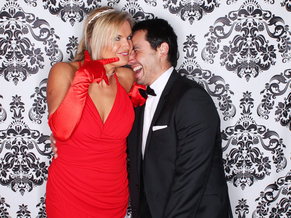 Photobooth rental for parties with lady in bright red dress